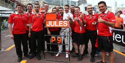 The team celebrates their first points finish at Monaco 2014.