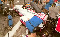 Mecanics work on Martin Donnelly's A11 at the 1989 French GP